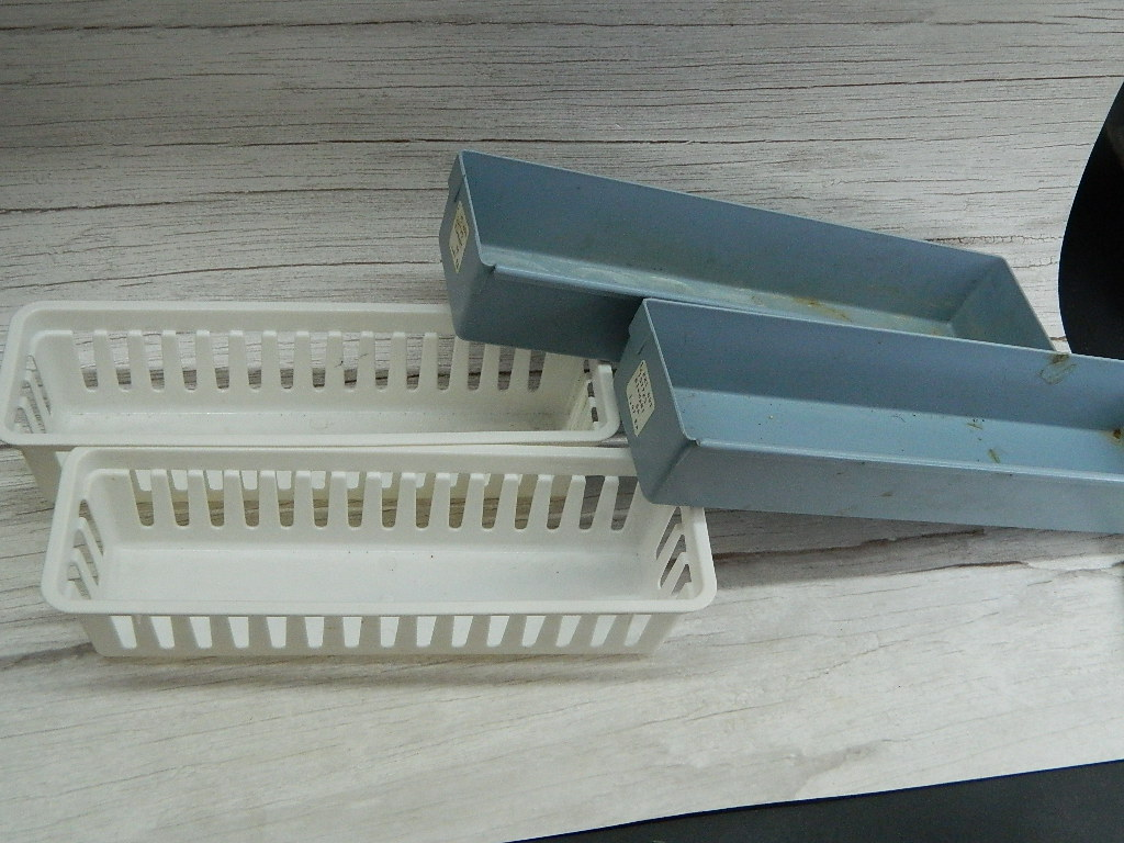 OE7699- Collection of 4 Blue and White Plastic Organizing Containers White Measures 2.5x3.25x10.25in Blue is 2x3.25x12in