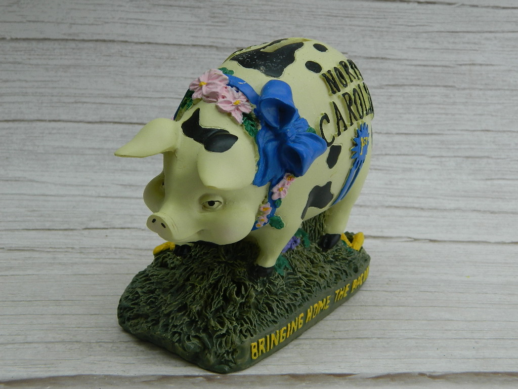 WN7709- Adorable Resin Made 'Bringing Home The Bacon' First Place Ribbon NORTH CAROLINA Small Piggy Bank Figurine '4.5x5in'