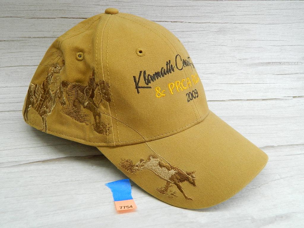 AA7754- MEN's Like New DRI-DUCK Wildlife Series Rodeo Themed 2009 Tan 'Klamath County Fair & PRCA Rodeo' Adjustable Billed Hat